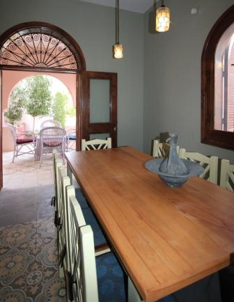 photo of dining table and terrace in Villa Arabesque