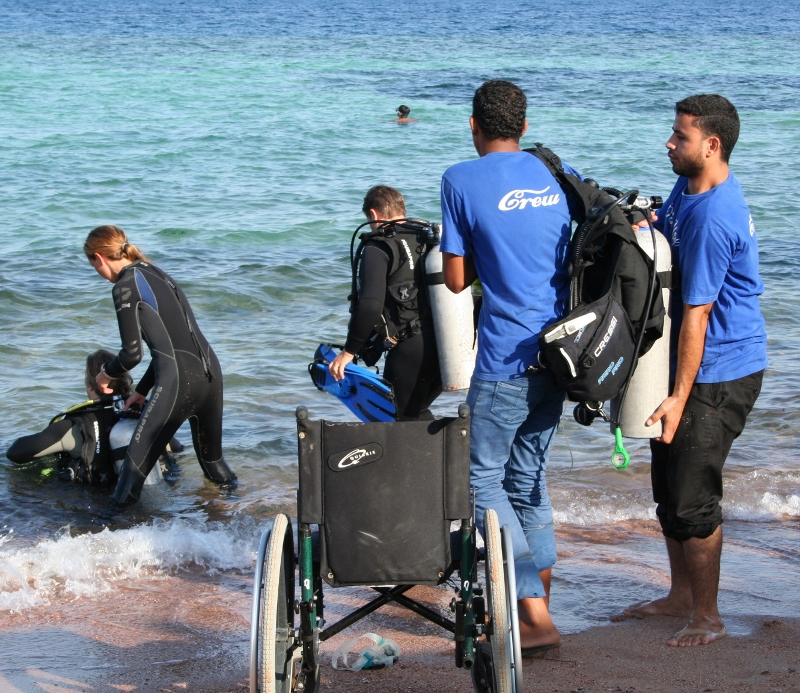 image of a disabled diver entering water