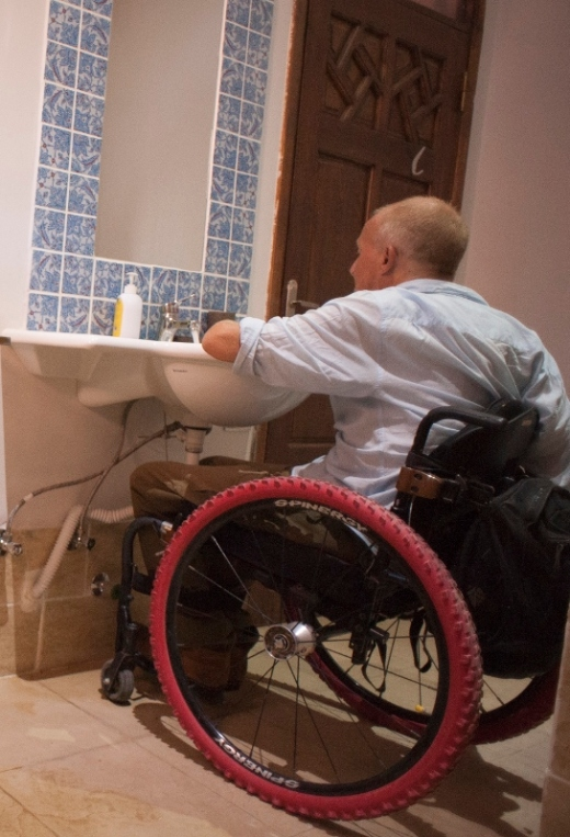 Image of wheelchair user in bathroom