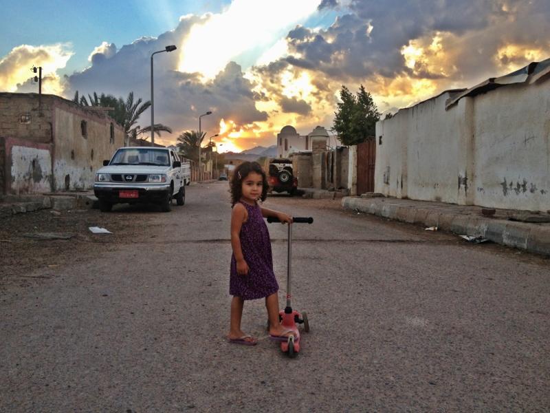 image of child walking in street